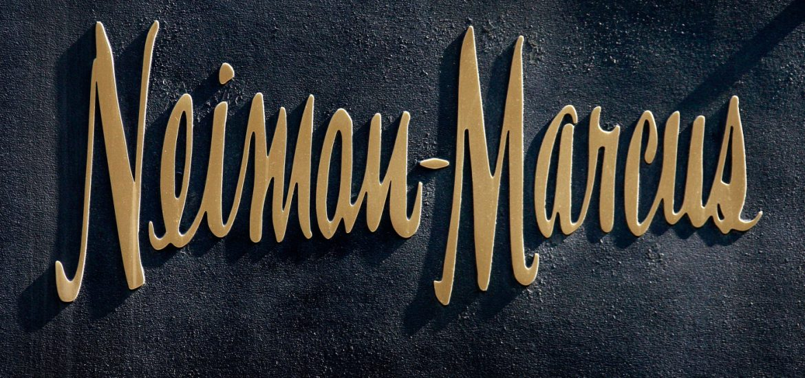 CHICAGO - MARCH 05:  A bronze logo hangs on the side of a Neiman Marcus store on the Magnificent Mile March 5, 2009 in Chicago, Illinois. Neiman Marcus Group Inc., which operates Neiman Marcus, recently reported a 24 percent decline in sales.  (Photo by Scott Olson/Getty Images)